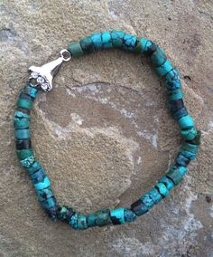 A personal favorite from my Etsy shop https://www.etsy.com/listing/224243714/shark-tooth-turquoise
