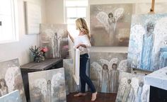 Original Abstract Angel Paintings Fine Art by Artist Christine Krainock in Art Studio. Christine creates stunning, textured, modern, spiritual angel paintings. Gallery fine art from her Southern California Artist Studio. Her artwork is collected & is displayed in public & private venues worldwide. Her work is a favorite w/ interior designers as a focal point for home decor room spaces.