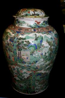Large Chinese famille verte vase, Kangxi (1662-1722) of balustersahpe, delicately painted with shaped panels depicting figures in various riverlandscape ...