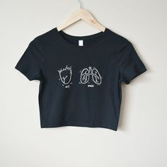 """Super soft and fitted crop top featuring a handdrawn heart & lungs design with the words """"art"""" and """"music"""" 52% cotton, 48% polyester Measurements: XS/S - Length: 16.5"""", Bust: 31"""" M/L - Length: 17.5"""", Bust: 34"""""""