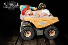 The hat is cute but I just love her idea with the baby in the Tonka truck. So cute! From My Baby Booties -Knit Baby Boy Crochet  Elf Hat photography  prop ready to ship. $15.00, via Etsy.