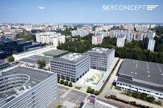 Wizualizacja biurowca Domaniewska Office HUB w Warszawie. Deweloper obiektu to Polski Holding Nieruchomości