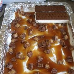 Ice Cream Sandwich Cake Recipe | Endless choices for the layers use candy and incredibly simple!  Made for my son's bday and got rave reviews.  Definitely making this again!  5/5  Marty says:  I made this but used Cool Whip, strawberries and chopped pecans.  Absolutely delicious and everyone loved it!