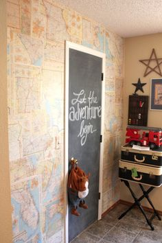 old road atlas wallpapered onto wall, chalkboard paint on door...FUN I like this idea...but maybe paint it on instead of chalk board so the girls can't leave each other nasty messages