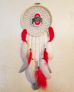《C U S T O M  O R D E R》      Ohio State Buckeyes #dreamcatchers #football #team #ohiosatebuckeyes #ohiosate #ohiostatefootball #footballteams #leather #lace #feathers #beads #doily #doilydreamcatchers #red #grey #white #homemade #handmade #lovewhatyoudo #savvydreamers #californiadreamers #california #calilife #boom Check out more @ SAVVY DREAMERS on FB & Instagram