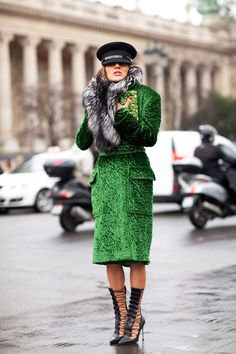 Paris Fashion Week:  Anna Dello Russo stays cozy in a textural suit and fur stole. I love the green and black together!