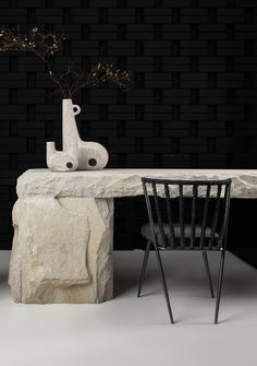 I am beyond obsessed with this raw stone desk and black chair and wall combo. Faina : Design ukrainien engagé entre tradition et modernité Stone Interior, Interior Design, Ceramic Furniture, Stone Bar, Coffee Bar Home, New York City Apartment, Square Tables, Dining Table Chairs, Office Decor