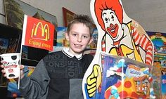 An 11-year-old boy was more than £8,000 richer today after his collection of memorabilia from fast food chain McDonald's went under the hammer.