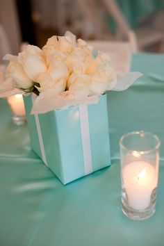 Tiffany wrapped boxes filled with white roses....beautiful center pieces