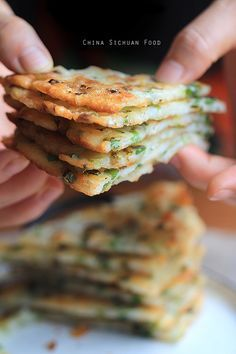 Easy Chinese Scallion Pancake  Cannot wait to try these! I've always done the version you ave to knead and roll. My kids love these.