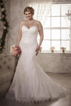 This Christina Wu Love 29279 strapless lace wedding dress with sweetheart neckline and lace-up back presents a trumpet silhouette. This plus size gown with chapel train finishes in a scalloped lace hemline.