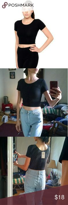 NWT AA crop tee NWT American Apparel cotton spandex Jersey crop tee in black. Size extra small. A fitted scoop-neck t-shirt that hits just above the waist. 95% cotton, 5% spandex. American Apparel Tops Crop Tops