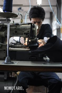 Momotaro Jeans Factory - A Japanese denim tailor putting in the fine details.