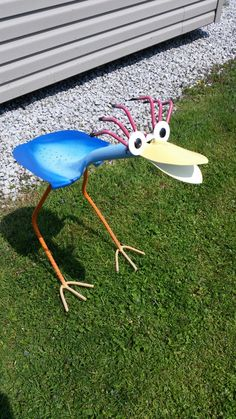 Yard art bird feeder recycled garden tools