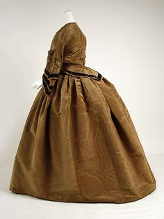 """1856-58 Dress - simple ribbon trim and puffs on sleeves (Dated by the MET--which I think is incorrect.  The """"bustle"""" at the back is likely mid-late 1860s.  I've never seen a photo or fashion plate showing such a bustle as early as they say this is.)"""