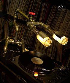 Desk lamp. Beer bottles. Plumbing pipe & fittings. Table lamp.