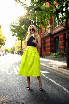 black collared top with neon skirt