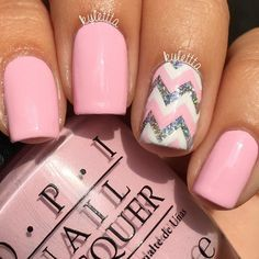Pale pink manicure with pink, white, and glitter chevron accent nail