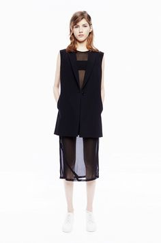 DKNY | Style Tip: Layer a long button-down vest over a sheer dress for a subtly sexy look.