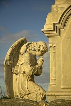 Photo about Angel sculpture praying in front of stone tomb, yellow dusk sun. Image of tombstone, graveyard, dead - 4020324 Cemetery Angels, Cemetery Statues, Cemetery Art, Angel Statues, Angels Among Us, Angels And Demons, Statue Ange, Old Cemeteries, Arts And Crafts