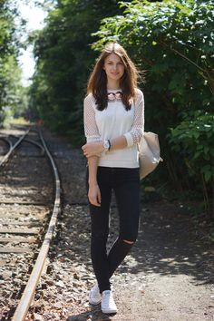 Railroad Tracks - wearing Frends Headphones in rosegold and a mesh sweater from Asos combined with black jeans, white chucks and my warehouse backpack  more on whaelse.com: http://www.whaelse.com/bahngleise/
