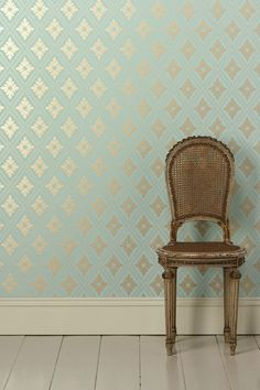 Go Bold With Graphic Wallpaper: The metallic diamond motif looks extra fresh against the aqua background of this Farrow & Ball Ranelagh Paper ($255 per roll).