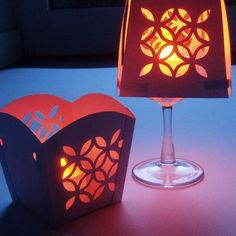 simple party table lamp made from Chinese take out boxes or card stock, using a punch or stencil to make the designs on the side.... slip a tea light in and done! simple but beautiful...