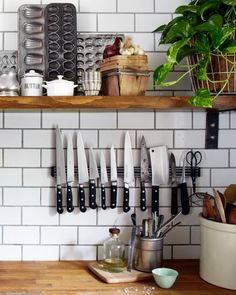 If you have a small kitchen, a knife block is pointless since it takes up valuable chopping space. Use a magnetic strip on your backsplash to hold your sharp utensils instead.