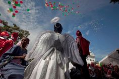 HAITI - DECEMBER 24, 2009 - Children wear costumes as they partake in a Christmas pageant at the presidential palace on Christmas Eve in Port-au-Prince