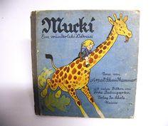 Mucki Eine wunderliche Weltreise Scholz Mainz 438 Das Kinderbuch ist im gebrauchten Zustand. Komplett  $45.00