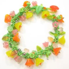 Floral Spiral Bracelet in citrus colors by Cheryl Erickson.  Instructions and kits available in this and other colors from www.artisticbead.com