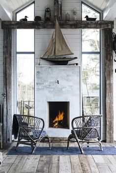 A contemporary house taken rustic is unique and perfect coastal living. Nice to see a fireplace with windows next to it. Coastal Homes, Coastal Living, Coastal Decor, Coastal Farmhouse, Coastal Cottage, Cozy Living, Cottages By The Sea, Beach Cottages, Style At Home