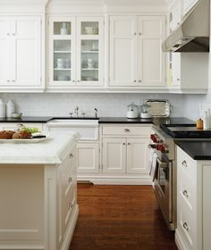 Love the setback at the sink in the upper cabinets. Also love that those are glass for a lighter look and to break up the wall of cabinetry. Cuisine authentique