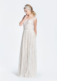 An exclusive dress for Nearly Newlywed by Austrailian designer, Paolo Sebastian, the Jolene is a stunning lace A-line gown inspired by the Swan Lake. With a nude corset built in, the bodice features b