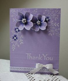 handmade card ... monochromatic purples ... clean and simple ... sweet design with white stamping and purple coloring on purple ... dimensional flowers too ...could use Secret Garden for the flowers