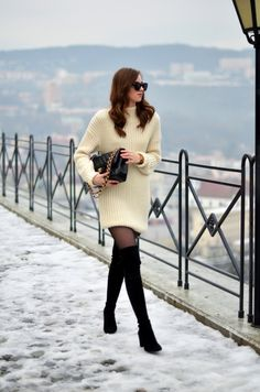 Wear thigh high boots like Barbora Ondrackova and pair them with a sweater dress and opaque tights. This look is sleek and stylish, perfect for the winter season. Dress: Topshop, Boots: Stuart Weitzman, Bag: Chanel.