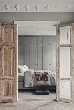 Bedroom with unfinished wooden doors