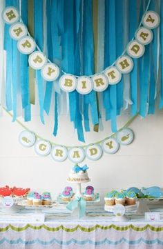 Streamers (colors!) and happy birthday sign for mermaid party