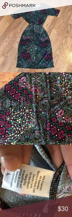 Large Lularoe Julia This dress is super flattering! The cream around the ribs makes you look thinner.  Optical illusions! 🎉😂 LuLaRoe Dresses High Low