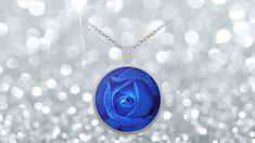 Blue Rose Necklace The Eye of the Rose Pendant     **The Eye of the Rose Blue Rose Necklace Pendant - This stunning blue rose image is detailed and brilliant with the morning dew on the Crisp Blue Rose Pedals.    **Blue Rose Pendant Necklace - Choice of Silver or Gold Plated.    **This Real Blue Rose Flower Necklace and Sterling plated pendant has a custom hardened resin insert to show the highest quality color and vibrance in your necklace as possible.
