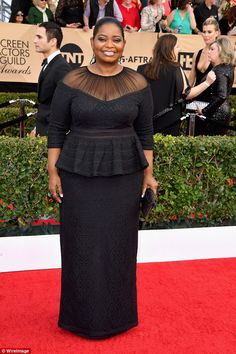 Elegant:Octavia Spencer was already stealing the show as she worked the SAG Awards red carpet in a glamorous black dress with a sheer neckline and peplum topin Los Angeles on Sunday