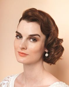 Old-Hollywood Waves: finger waves dress up this otherwise simple style for a glammed-out look reminiscent of the red carpet.