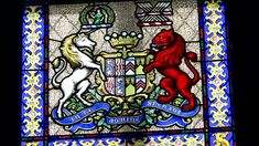 Glamis Castle stained glass window with coat of arms.
