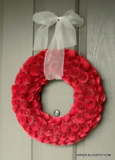 amazing paper rose wreath.  I'm going to use my previous pin for how to on paper roses to make this <3     ...shelterness.com