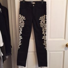 Tobi Black denim with white embroidery Purchased from Tobi. Never worn. Size small. I would consider them a size 25 as well. Black denim with white embroidery down the pant leg. Tobi Pants Straight Leg