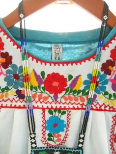 Handmade Mexican embroidered dresses and vintage treasures from Aida Coronado Mexican dress for baby children A heart in every piece