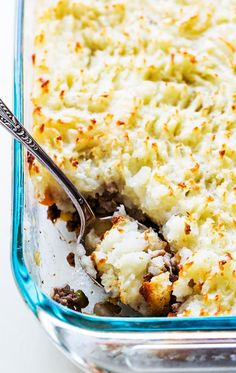 American favorite shepherd's pie recipe! Casserole with ground beef, vegetables such as carrots, corn, and peas, topped with mashed potatoes. On SimplyRecipes.com #EasyDinner #Dinner #GlutenFree #ShepherdsPie
