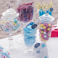 apothecary jars help to create a visually appealing candy buffet