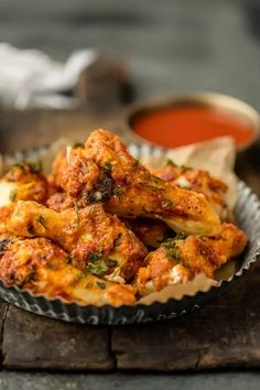 Simple Spiced Baked Chicken Wings are rubbed with simply paprika, garlic, and salt and pepper. THESE ARE SO DELICIOUS! This easy recipe is perfect with any dipping sauce. Crispy Oven Baked Wings do exist! Easy Baked Chicken Wings, Spicy Baked Chicken, Cooking Chicken Wings, Cooking Pork, Chicken Legs, Healthy Chicken, Fried Chicken, Potluck Recipes, Easy Dinner Recipes