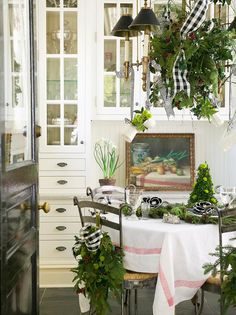 Christmas tablescape with lush greenery, black and white ribbons | Mary Carol Garrity